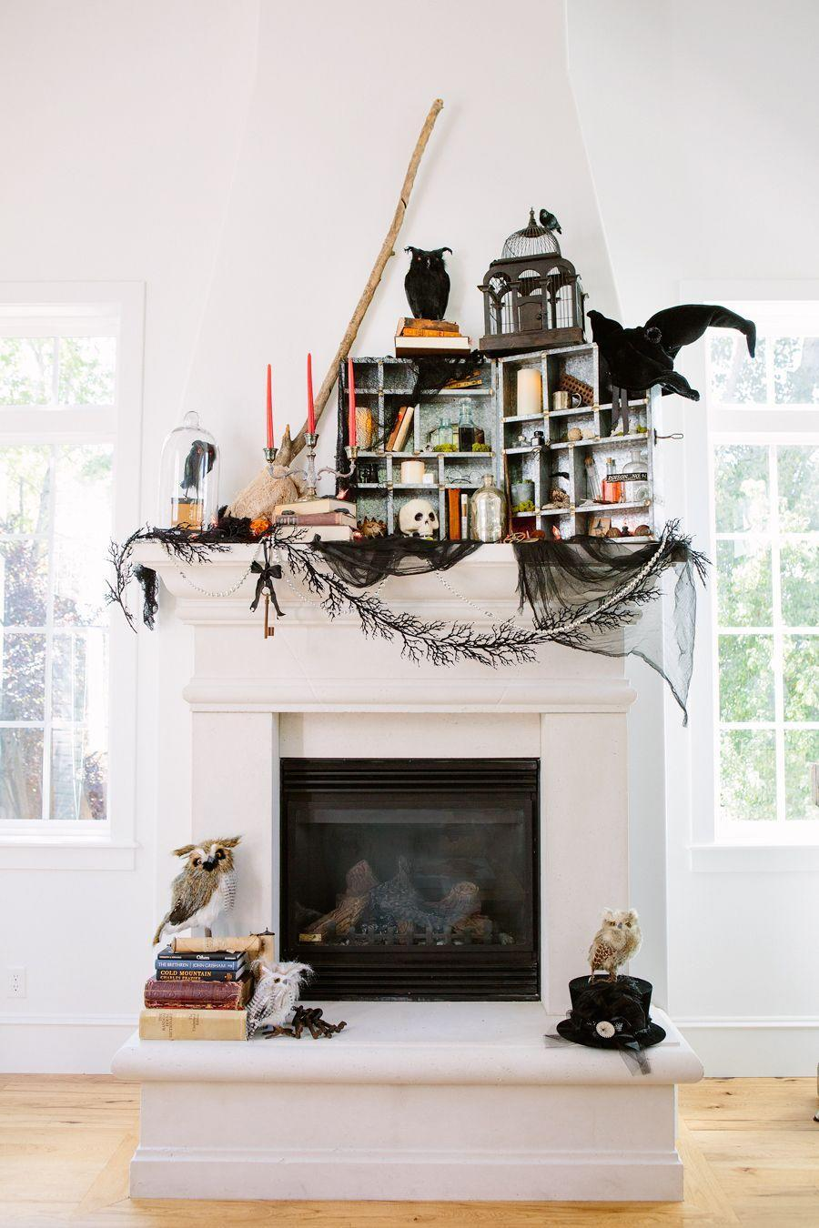 "<p>Draw the eye up on your fireplace mantel by decorating with themed objects, like broomsticks and witches' hats. Get the tutorial at <a href=""http://handmademood.com/a-step-by-step-guide-to-decorating-your-mantle/"" rel=""nofollow noopener"" target=""_blank"" data-ylk=""slk:Handmade Mood"" class=""link rapid-noclick-resp"">Handmade Mood</a>.</p><p><a class=""link rapid-noclick-resp"" href=""https://www.amazon.com/Touch-Nature-21722-1-Piece-Feather/dp/B008H55WIA/ref=sr_1_4?tag=syn-yahoo-20&ascsubtag=%5Bartid%7C10057.g.2554%5Bsrc%7Cyahoo-us"" rel=""nofollow noopener"" target=""_blank"" data-ylk=""slk:BUY NOW"">BUY NOW</a> <strong><em>Faux Flying Crow, $12</em></strong></p>"