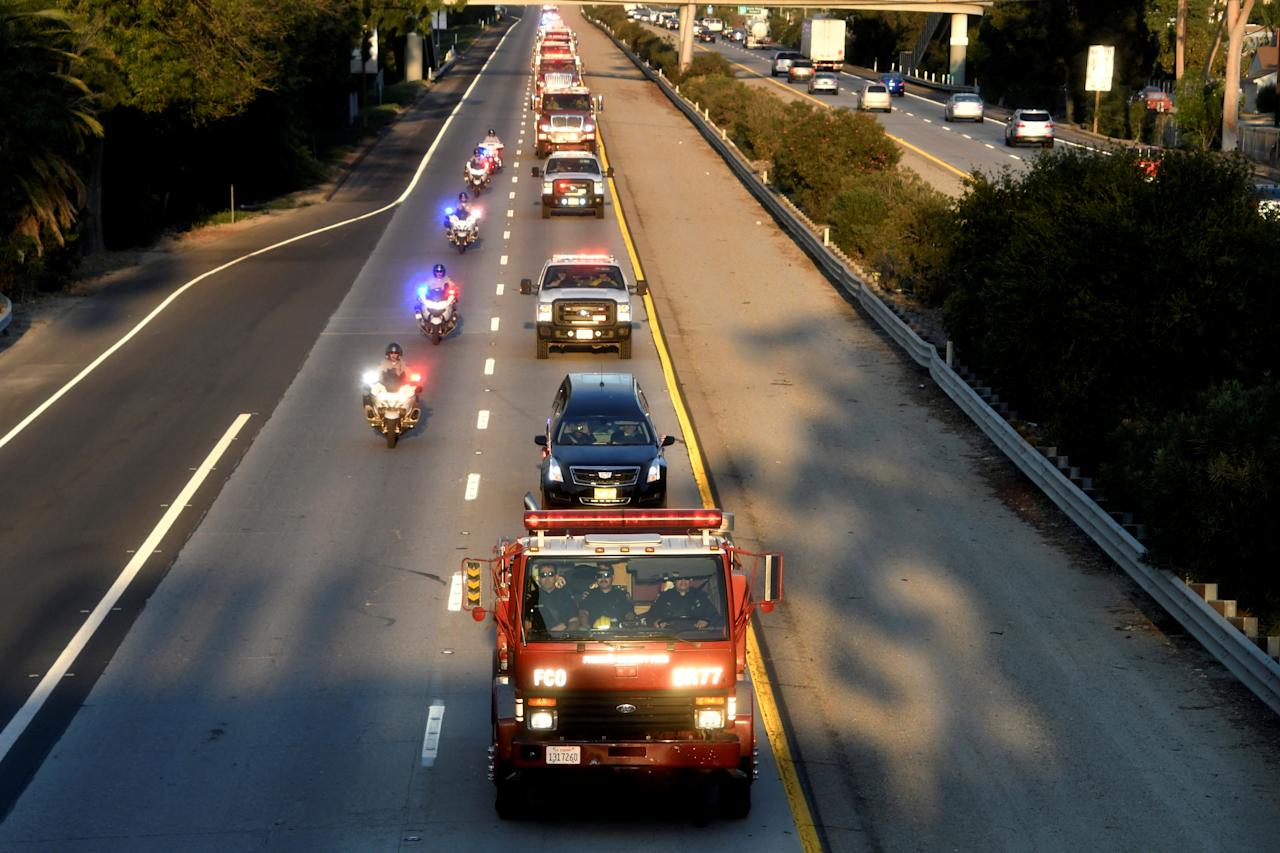 <p>A procession of firefighting vehicles passes through Santa Paula, while carrying the body of a fellow firefighter who was killed today battling the Thomas wildfire near Fillmore, Calif., Dec. 14, 2017. (Photo: Gene Blevins/Reuters) </p>