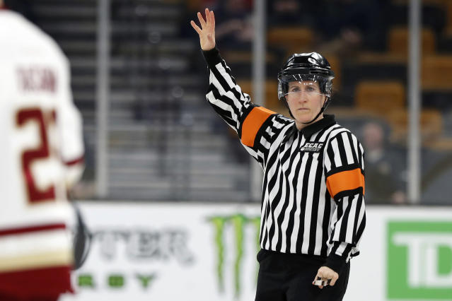 FILE - In this Feb 4, 2019, file photo, referee Katie Guay watches a Boston College line change during a Beanpot Tournament NCAA college hockey game against Harvard in Boston. Guay and Kirsten Walsh were among four females selected by the NHL on Friday, Sept. 6, 2019, to be the first women to work as on-ice officials at several prospect tournaments taking place across the country this weekend. The other two women selected were Kelly Cooke and Kendall Hanley. (AP Photo/Winslow Townson, FIle)