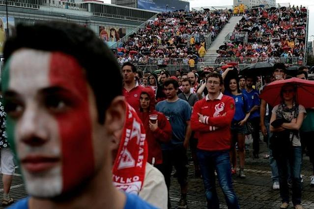 Italian and Polish fans watch the broadcast of the Euro 2012 football championships match Spain vs. Italy on June 10, 2012 in the fanzone in Warsaw . AFP PHOTO / ARIS MESSINISARIS MESSINIS/AFP/GettyImages
