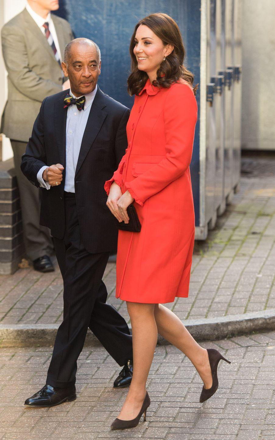 """<p>The Duchess wore a bright coat by Boden for a visit to Great Ormond Street Hospital. <a href=""""https://www.townandcountrymag.com/society/tradition/a15392557/kate-middleton-not-wearing-engagement-ring/"""" rel=""""nofollow noopener"""" target=""""_blank"""" data-ylk=""""slk:Noticeably missing was Kate's signature engagement ring"""" class=""""link rapid-noclick-resp"""">Noticeably missing was Kate's signature engagement ring</a>, which she removed before her visit due to hygiene requirements at the hospital. </p>"""