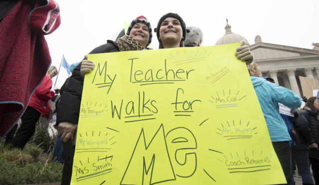 <p>Ella Roach holds a protest sign in support of her teacher, Kimberly Cox, during a rally at the state Capitol on April 2, 2018, in Oklahoma City. (Photo: J Pat Carter/Getty Images) </p>