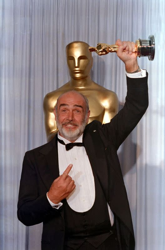 FILE PHOTO: Actor Sean Connery holds up his Oscar after winning Best Supporting Actor at the 60th Academy Awards in Los Angeles