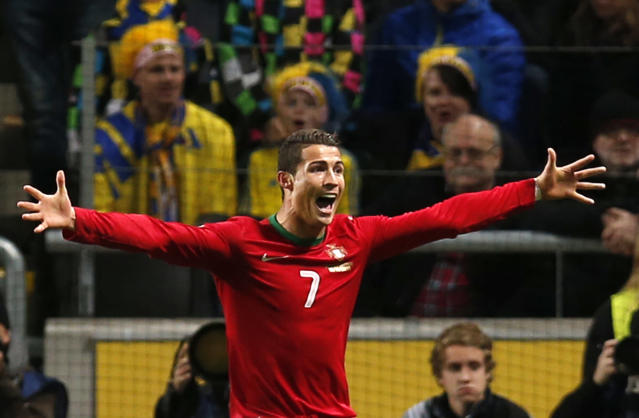 Portugal's Cristiano Ronaldo celebrates scoring his side's 3rd goal during the World Cup qualifying playoff second leg soccer match between Sweden and Portugal in Stockholm, Sweden, Tuesday, Nov.19, 2013. (AP Photo/Frank Augstein)