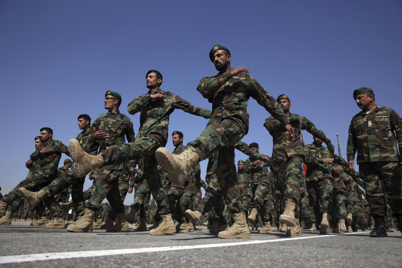 FILE - In this Monday, Feb. 24, 2020 photo, newly graduated Afghan National Army march during their graduation ceremony after a three month training program at the Afghan Military Academy in Kabul, Afghanistan. Many Afghans view Saturday's expected signing of a U.S.-Taliban peace deal with a heavy dose of well-earned skepticism. They've spent decades living in a country at war -- some their whole lives — and wonder if they can ever reach a state of peace. (AP Photo/Rahmat Gul, File)