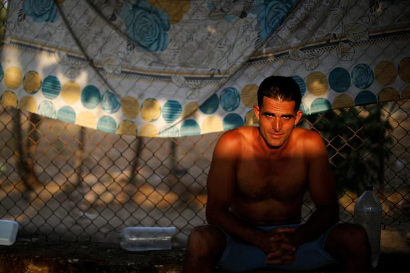 A cuban migrant rests at an improvised shelter while waiting for his humanitarian visa to cross the country on his way to the United States, in Mapastepec