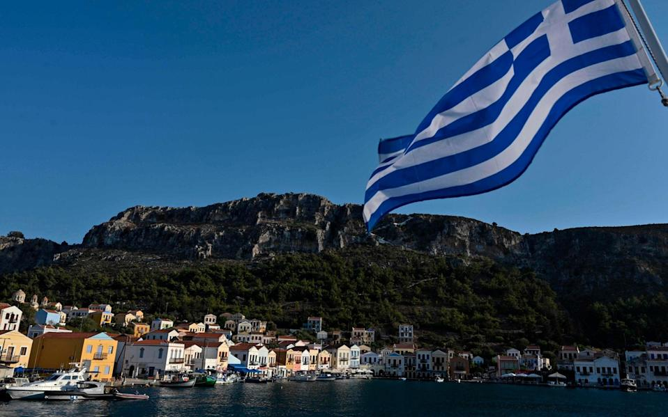 The Greek island of Kastellorizo lies about a mile off the Turkish coast - AFP