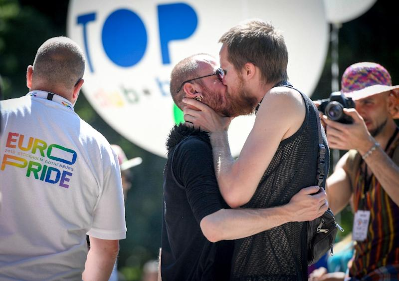 Two men kiss at the Baltic Pride parade in Latvia's capital Riga (AFP Photo/Ilmars ZNOTINS)