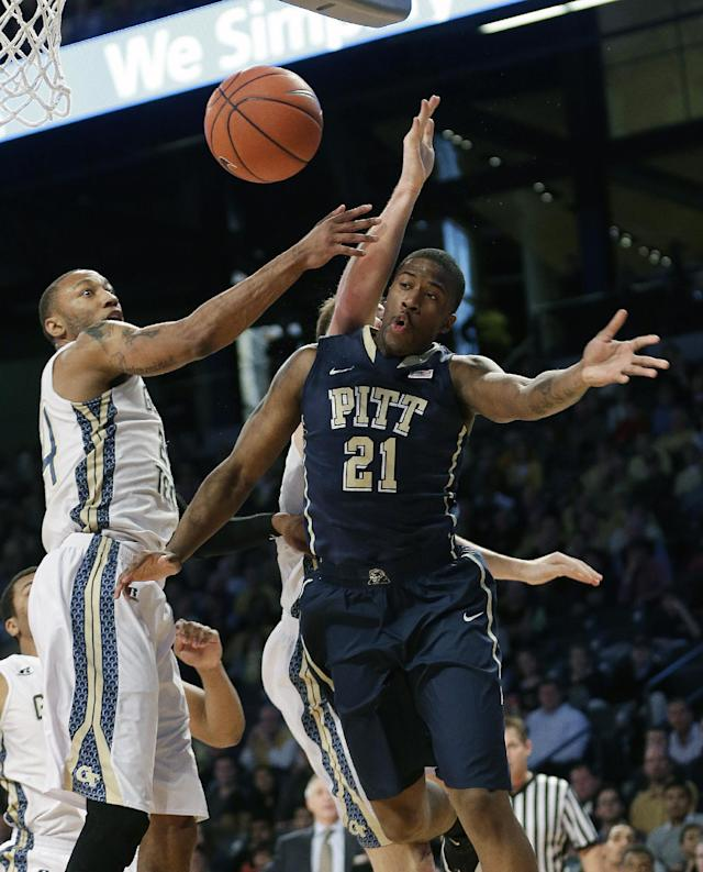 Pittsburgh forward Lamar Patterson (21) passes as Georgia Tech forward Kammeon Holsey (24) defends in the first half of an NCAA college basketball game, Tuesday, Jan. 14, 2014, in Atlanta. (AP Photo/John Bazemore)