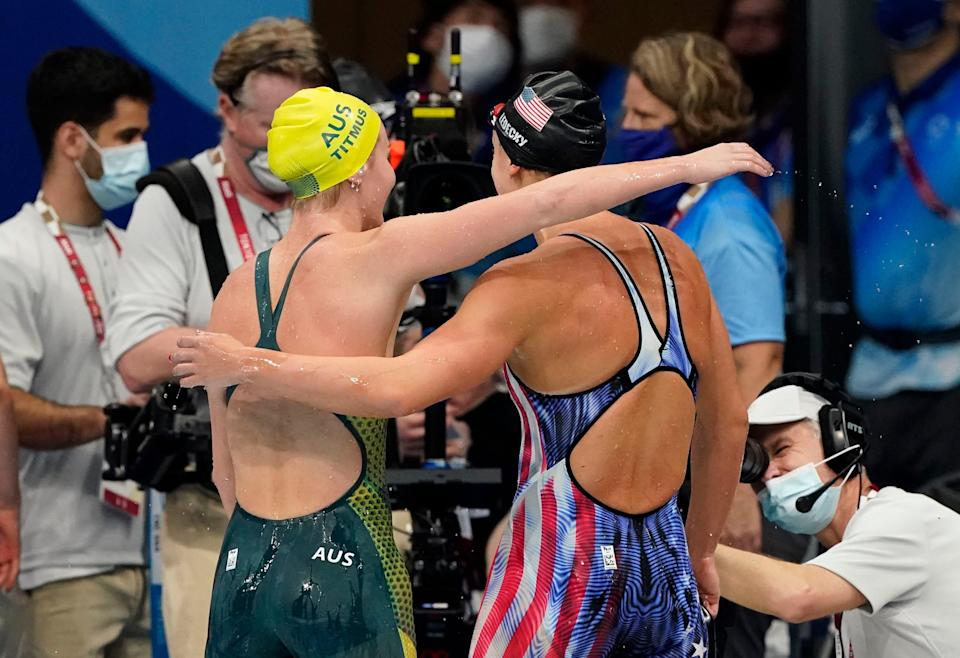 Ariarne Titmus (AUS) hugs Katie Ledecky (USA) after the women's 400m freestyle final during the Tokyo 2020 Olympic Summer Games at Tokyo Aquatics Centre.