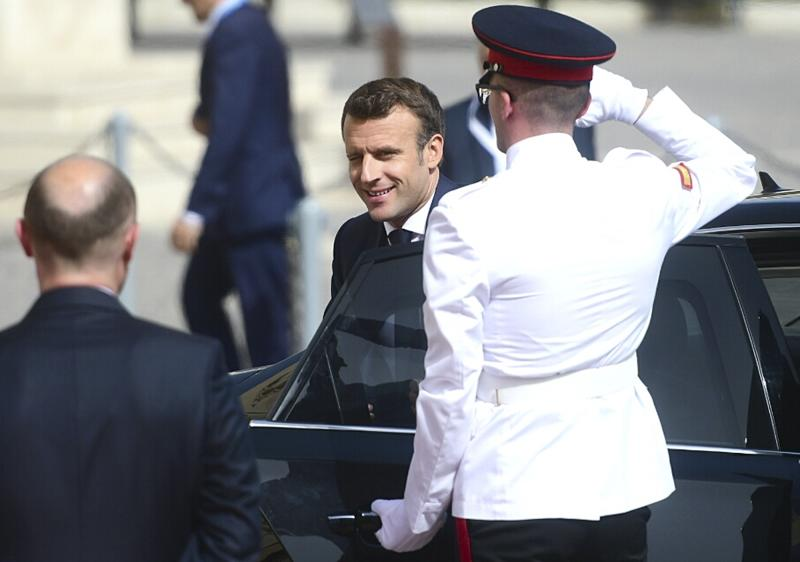French President Emmanuel Macron is welcomed by Malta Prime Minister Joseph Muscat, left, on the occasion of the Mediterranean Summit of Southern EU countries in Valetta, Malta, Friday, June 14, 2019. (AP Photo/Jonathan Borg)
