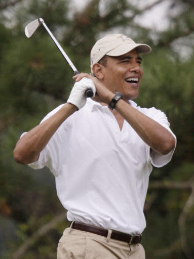 Bush says Obama shouldn't be criticized for golf