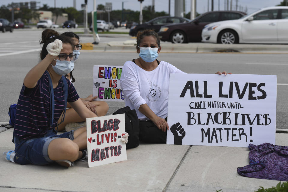 Protesters seen demonstrating peacefully during the protests for George Floyd on June 8, 2020 in Boca Raton, Florida. Credit: mpi04/MediaPunch /IPX