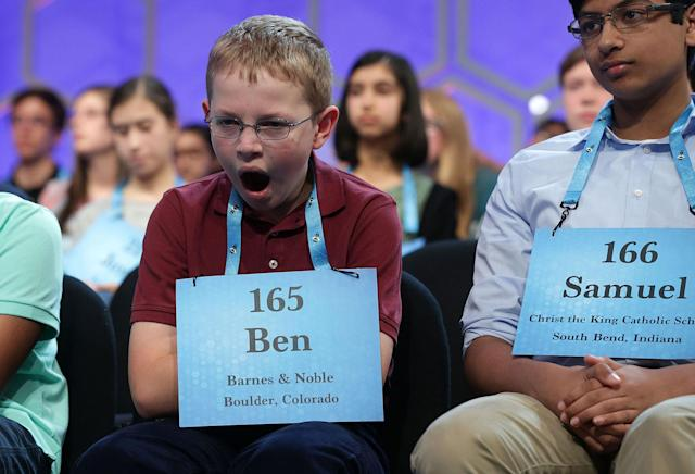 <p>Ben Lenger of Niwot, Colorado, yawns as he waits on stage during round two of 2017 Scripps National Spelling Bee at Gaylord National Resort & Convention Center May 31, 2017 in National Harbor, Maryland. Close to 300 spellers are competing in the annual spelling contest for the top honor this year. (Alex Wong/Getty Images) </p>