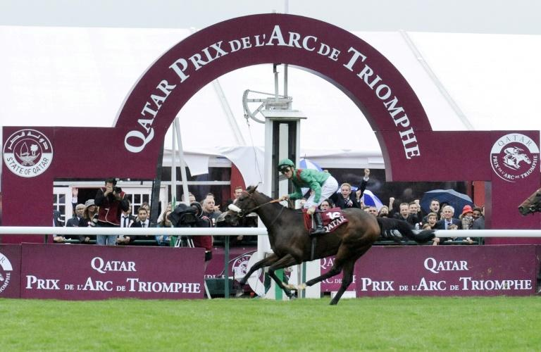 Christophe Soumillon threw his helmet and whip into the crowd whilst the Aga Khan owner and breeder of 2008 Arc de Triomphe winner Zarkava said her victory was the apogee of his family's time breeding horses (AFP/STEPHANE DE SAKUTIN)