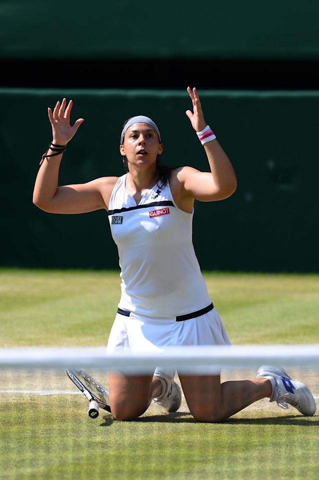 LONDON, ENGLAND - JULY 06: Marion Bartoli of France celebrates match point during the Ladies' Singles final match against Sabine Lisicki of Germany on day twelve of the Wimbledon Lawn Tennis Championships at the All England Lawn Tennis and Croquet Club on July 6, 2013 in London, England. (Photo by Mike Hewitt/Getty Images)