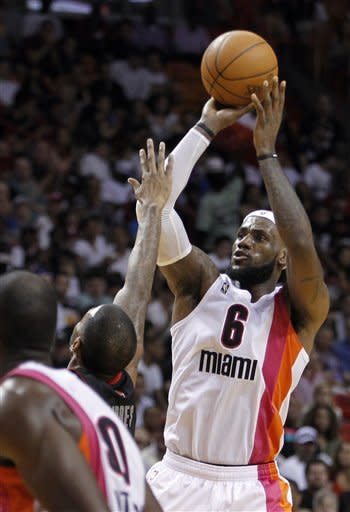 Miami Heat's LeBron James (6) shoots against the Toronto Raptors in the second half of an NBA basketball game in Miami, Sunday, Feb. 5, 2012. The Heat won 95-89. (AP Photo/Alan Diaz)