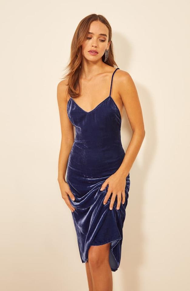 """<p>This <a href=""""https://www.popsugar.com/buy/Reformation-Moore-Velvet-Midi-Slipdress-533445?p_name=Reformation%20Moore%20Velvet%20Midi%20Slipdress&retailer=shop.nordstrom.com&pid=533445&price=248&evar1=fab%3Aus&evar9=47030897&evar98=https%3A%2F%2Fwww.popsugar.com%2Fphoto-gallery%2F47030897%2Fimage%2F47030982%2FReformation-Moore-Velvet-Midi-Slipdress&list1=shopping%2Cdresses%2Choliday%2Csequins%2Cnew%20years%20eve%2Cnew%20year%2Cwinter%20fashion%2Choliday%20fashion&prop13=api&pdata=1"""" rel=""""nofollow"""" data-shoppable-link=""""1"""" target=""""_blank"""" class=""""ga-track"""" data-ga-category=""""Related"""" data-ga-label=""""https://shop.nordstrom.com/s/reformation-moore-velvet-midi-slipdress/5482875/full?origin=category-personalizedsort&amp;breadcrumb=Home%2FWomen%2FClothing%2FDresses%2FCocktail%20%26%20Party&amp;color=danube"""" data-ga-action=""""In-Line Links"""">Reformation Moore Velvet Midi Slipdress</a> ($248) will be so comfortable to dance in all night.</p>"""