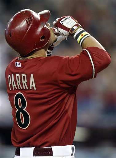 Arizona Diamondbacks' Gerrardo Parra celebrates as he crosses home plate after hitting a grand slam off Atlanta Braves pitcher Randall Delgado in the second inning of a baseball game on Sunday, April 22, 2012, in Phoenix. (AP Photo/Paul Connors)