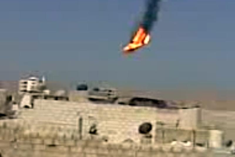 This citizen journalism image made from video provided by Shaam News Network SNN and taken on Monday, Aug. 27, 2012, purports to show a Syrian military helicopter on fire and falling to the ground after it was apparently hit during fighting between government forces and rebels in the capital Damascus, Syria. The helicopter's downing comes amid a widening government offensive to recapture districts in Damascus and its suburbs that have fallen into rebel hands. (AP Photo/Shaam News Network, SNN)THE ASSOCIATED PRESS IS UNABLE TO INDEPENDENTLY VERIFY THE AUTHENTICITY, CONTENT, LOCATION OR DATE OF THIS CITIZEN JOURNALIST IMAGE