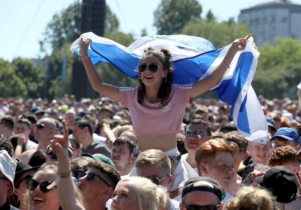 Music fans bask in the sun at a festival in Glasgow (PA)