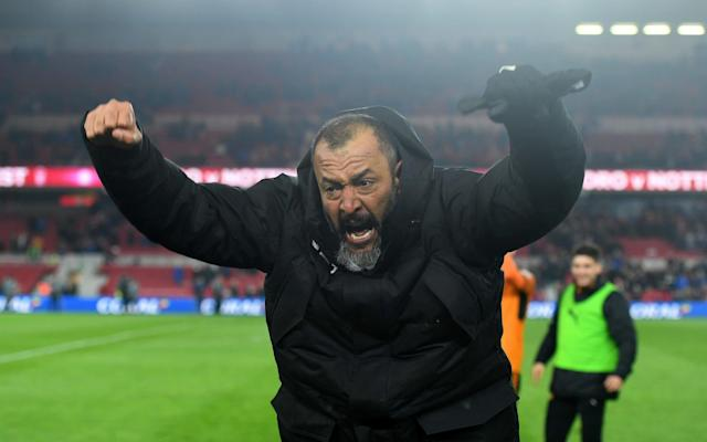 "Nuno Espirito Santo was forced to defend himself amidst suggestions he had celebrated excessively after Wolverhampton Wanderers took another significant step towards clinching a Premier League return. Tony Pulis refused to criticise his opposite number, despite an incendiary reaction from the Portuguese coach, after a dramatic victory for the nine-man Championship leaders saw the Molineux manager gesticulate wildly while jumping provocatively in front of the Middlesbrough bench. ""I didn't see all the incidents afterwards, they were obviously delighted as they'd just won,"" Pulis said, after a pulsating contest that saw the visitors play out the final 20 minutes two men down after red cards for Ruben Neves and Matt Doherty. ""To be honest, I don't know the fella (Nuno),"" Pulis added. ""It might be different if he was someone I knew. I'd have been delighted as well, but I'd have reacted differently. He's very welcome to come into my room, but I doubt he will."" For his part, Nuno admitted his emotions momentarily got the better of him as his side restored their six-point advantage at the top of the table thanks to a first victory on Teeside since 1951. In mitigation, he insisted he wasn't alone, though the regular sight of at least four of his backroom staff sprinting from the visitor's bench to protest every contentious decision soon became grating. ""Everyone in the stadium lost control,"" Nuno insisted, claiming decisions by Stuart Attwell, who issued 10 yellow cards in addition to two reds, added to the fractious atmosphere, although Pulis reserved praise for the referee. ""It's difficult to control your emotions when a bad decision can cost you,"" the Molineux manager added. ""The referee was not able to control the teams."" Even with nine men, Wolves look too good for the Championship. It appears increasingly a matter of when, not if, they are promoted back to the Premier League as in the space of 90 breathless minutes they accumulated more points than they had managed over the previous 26 years in this corner of the North East. They now require a maximum of three wins from their remaining seven games, and their elevation to the top flight is likely to be sealed on April 11 when they entertain Derby County, another of the pre-season promotion favourites who, like Middlesbrough, have been left to fight for the minor placings in what is starting to resemble a procession for pole position. Wolves are unbeaten in 27 games when they have taken the lead this season, meaning the outcome here looked in little doubt once the visitors' dominance was rewarded by scoring twice in the space of five minutes as half-time approached. Ivan Cavaleiro celebrates scoring for Wolves Credit: GETTY IMAGES Barry Douglas was the source of both goals, first when showing his vision to send over an inviting cross in the 32nd minute for the unmarked Helder Costa to volley in a fourth goal in his last nine league appearances, after Boro failed to clear when the Portuguese midfielder saw his initial shot from a narrow angle saved by Darren Randolph. The advantage was soon doubled, Randolph saving Willy Boly's near-post header from a Douglas corner, only for the ball to loop across goal where Ivan Cavaleiro had the simple task of nodding home into an unguarded net. With Wolves content to sit back and defend their lead, the onus fell on Middlesbrough to make the running after the break, but it was a task which proved largely beyond them as the visitors coped with relative ease, at least until Neves made an unnecessarily early exit with 25 minutes remaining, picking up a second caution inside two minutes for an ugly lunge at George Friend. Doherty's second caution for a flailing elbow, Friend again the victim, as the pair challenged for an aerial ball saw Wolves further diminished shortly after, but their opponents failed to take advantage until Patrick Bamford's fine volley in the fourth minute of stoppage time set up a nervy final 90 seconds. Wolves safely negotiated it, though, to cap a display which speaks volumes for the qualities possessed by the best team currently outside the Premier League. Pulis said: ""They've invested well and will do so again when they go up."" Team details Middlesbrough (4-3-3) Randolph; Shotton (Cranie 70), Ayala, Gibson, Friend; Clayton (Assombalonga 70), Leadbitter (Howson 63), Besic; Traore, Bamford, Downing. Subs: Konstantopoulos, Fry, Baker, Harrison Wolves (3-4-3) Ruddy; Bennett, Coady, Boly; Doherty, Saiss, Neves, Douglas; Costa (Gibbs-White 84), Afobe (Bonatini 63), Cavaleiro (N'Diaye 58). Substitutes: Norris, Batth, Vinagre, Hause. Referee Stuart Attwell (Warwickshire)"