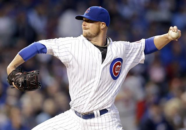 Chicago Cubs starter Jon Lester throws during the first inning of a Major League Baseball season-opening game against the St. Louis Cardinals in Chicago, Sunday, April 5, 2015. (AP Photo/Nam Y. Huh)
