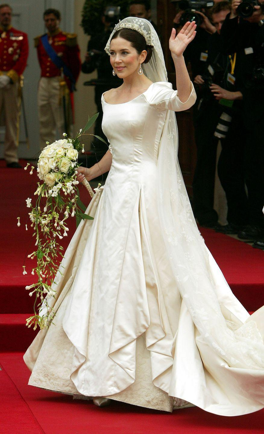 <p>Mary Elizabeth Donaldson wore a beautifully fitted gown with three-quarter length sleeves and pleating down the front, for her marriage to Danish Crown Prince Frederik. </p>