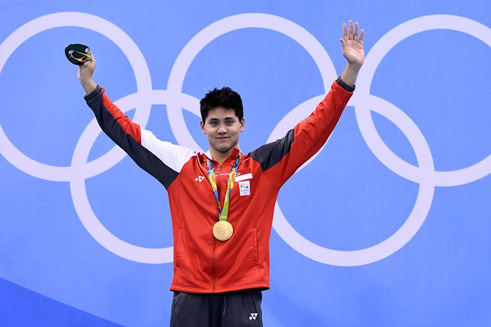 Singapore's Schooling Joseph poses with his gold medal on the podium of the Men's 100m Butterfly Final during the swimming event at the Rio 2016 Olympic Games at the Olympic Aquatics Stadium in Rio de Janeiro on August 12, 2016.   / AFP / GABRIEL BOUYS        (Photo credit should read GABRIEL BOUYS/AFP via Getty Images)