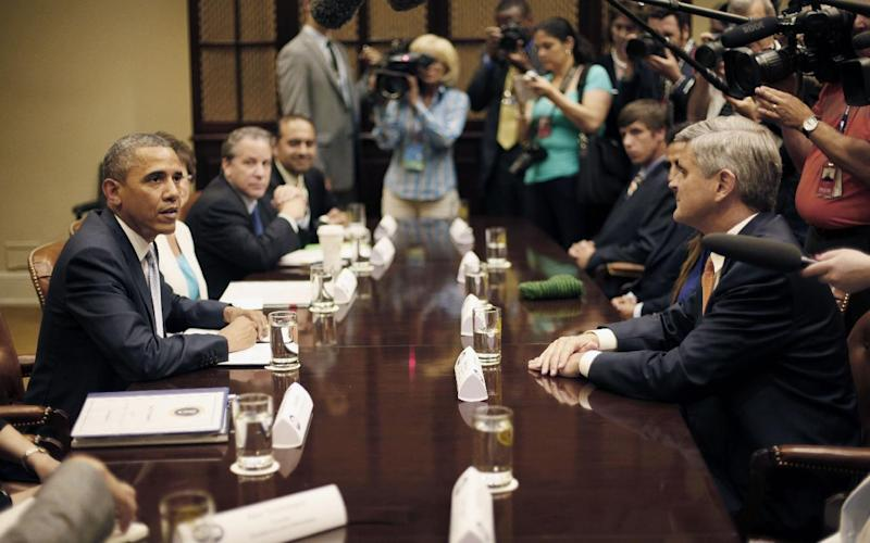 President Barack Obama, right, sit across from Steve Case, right, Chairman and CEO, Revolution LLc, and other CEOs, business owners and entrepreneurs during a meeting in the Roosevelt Room of the White House in Washington, Monday, June 24, 2013, to discuss immigration reform. Obama hosted the meeting to discuss the importance of commonsense immigration reform including the Congressional Budget Office analysis that concludes immigration reform would promote economic growth and reduce the deficit. (AP Photo/Pablo Martinez Monsivais)