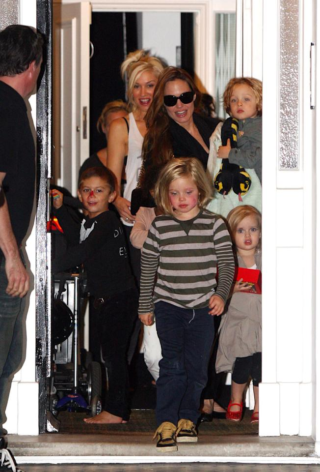 """New best friends? Angelina Jolie and Gwen Stefani put on a playdate on Monday at Gwen and hubby Gavin Rossdale's North London home. In addition to Gwen and Gavin's two boys -- Kingston, 5, and Zuma, 3 -- Angelina brought four of her six kiddies -- 3-year-old twins Knox and Vivienne, 5-year-old Shiloh, and 6-year-old Zahara. Gotcha Images/<a href=""""http://www.splashnewsonline.com"""" target=""""new"""">Splash News</a> - September 26, 2011"""