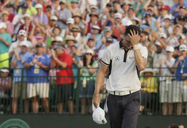 Martin Kaymer, of Germany rects after winning the U.S. Open golf tournament in Pinehurst, N.C., Sunday, June 15, 2014. (AP Photo/Charles Riedel)
