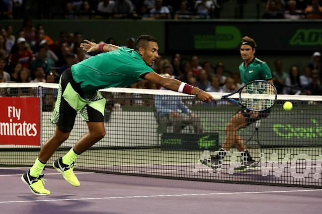 Nick Kyrgios of Australia stretches for a shot against Roger Federer of Switzerland in the semi-finals at the Miami Open (AFP Photo/JULIAN FINNEY)