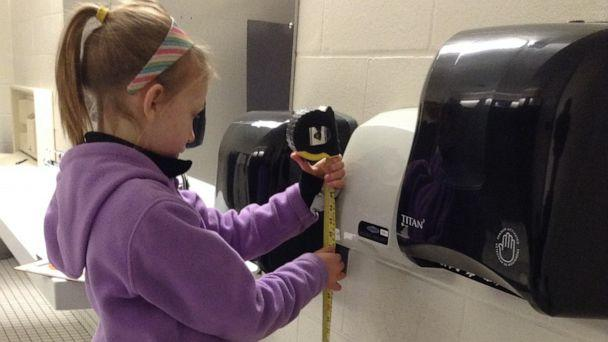 PHOTO: Nora Keegan, then 9, measures a hand dryer's volume in 2016. (Susan Bannister)