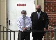 In this image from video, Roddy Bryant, accused in the slaying of Ahmaud Arbery, is led by security officers from the Glynn County Courthouse in Brunswick, Ga., Wednesday, May 12, 2021. A Georgia judge will continue hearing legal motions Thursday in the murder case of three men facing a fall trial in the slaying of Arbery, a Black man who was chased and shot after being spotted running in the defendants' neighborhood. (AP Photo/Lewis M. Levine)