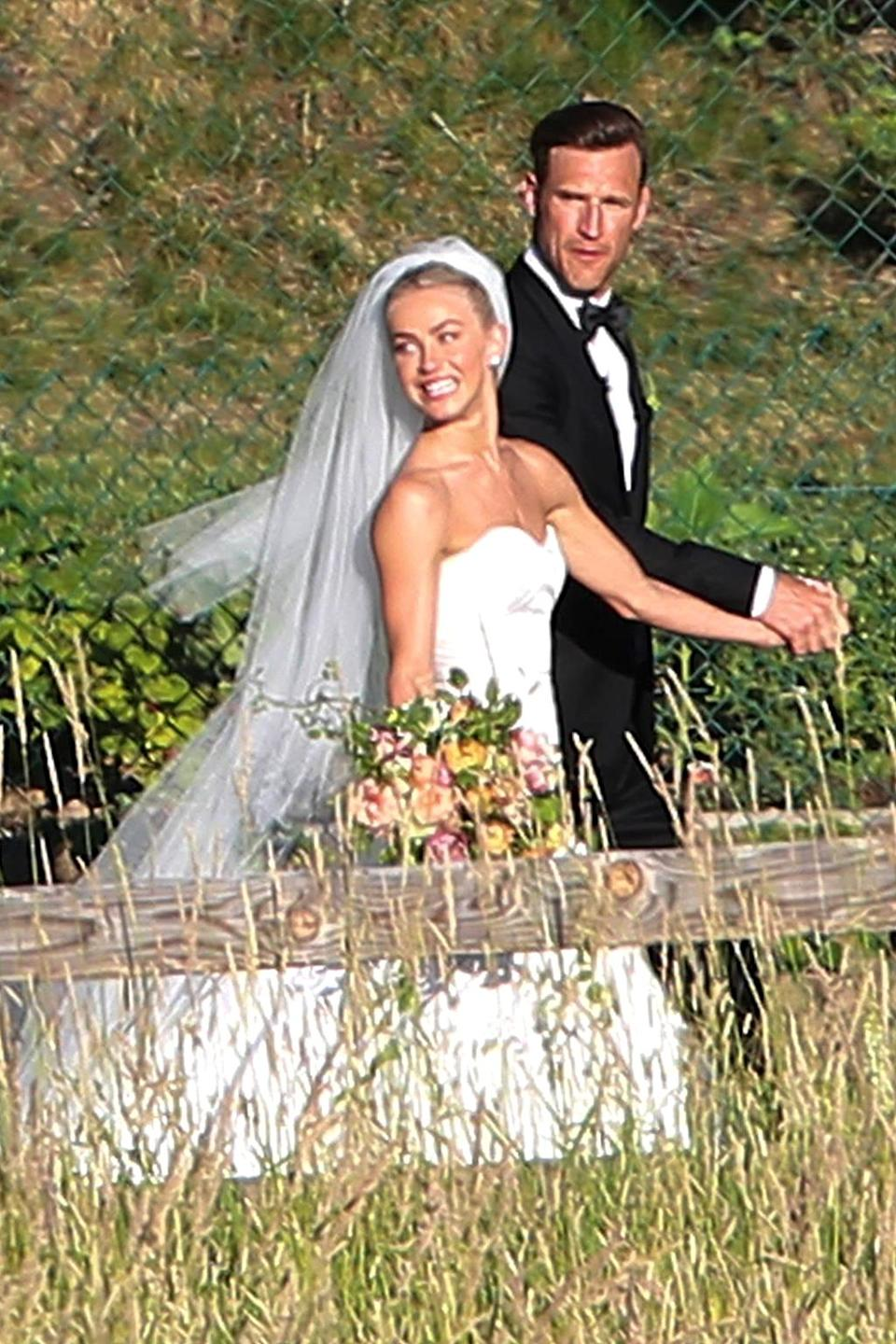 <p>Meet the Laiches! Julianne Hough and Brooks Laich tied the knot in front of friends and family in an intimate lakeside ceremony in Coeur d'Alene, Idaho. Naturally, they both looked stunning. That's one good looking Mr. and Mrs. (Photo: BACKGRID) </p>