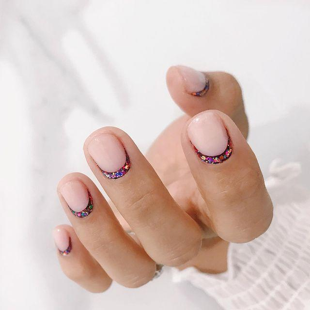 """<p>Switch your French manicure on its head, and apply a curve of glitter just above your cuticles.</p><p><a href=""""https://www.instagram.com/p/Byz9T74nhCU/"""" rel=""""nofollow noopener"""" target=""""_blank"""" data-ylk=""""slk:See the original post on Instagram"""" class=""""link rapid-noclick-resp"""">See the original post on Instagram</a></p>"""