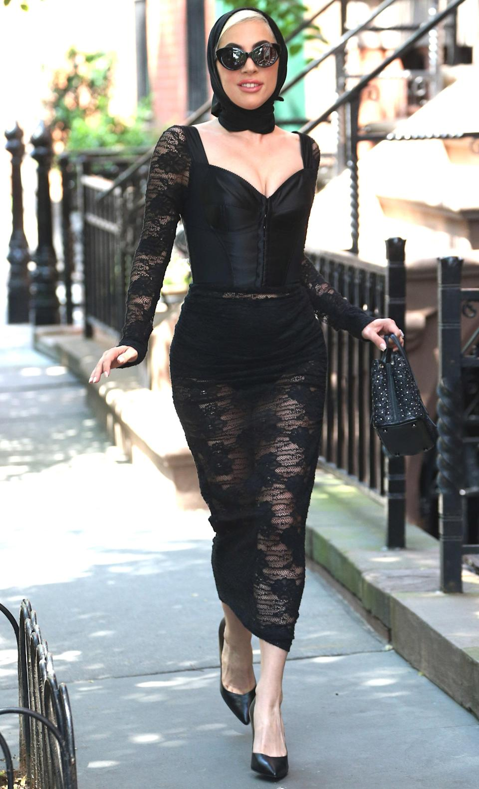 <p>Finally, she finished the four days in a black lace number that gave off what one could only describe as sexy widow vibes. Mourning the end of the weekend, perhaps? [Photo: Rex] </p>