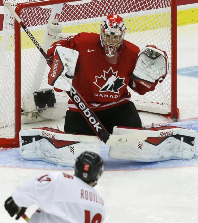 Canada's goalie Zachary Fucale makes a save on Switzerland's Anthony Rouiller during the third period of their IIHF World Junior Championship quarter-final ice hockey game in Malmo, Sweden, January 2, 2014. REUTERS/Alexander Demianchuk (SWEDEN - Tags: SPORT ICE HOCKEY)