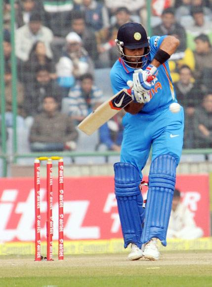 Virat Kohli (India) in an action against Pakistan during the 3rd One Day Internationals Match between India & Pakistan at Ferozeshah Kotla Stadium in Delhi on January 6, 2013. P D Photo by Manoj