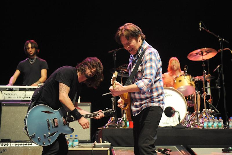 Musician Dave Grohl, left, and John Fogerty perform on stage at the Sound City Players concert at The Manhattan Center Hammerstein Ballroom, Wednesday, Feb. 13, 2013, in New York. (Photo by Brad Barket/Invision/AP)