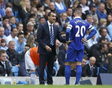 Everton's manager Roberto Martinez (L) talks with Ross Barkley during their English Premier League soccer match against Manchester City at the Etihad Stadium in Manchester, northern England, October 5, 2013. REUTERS/Darren Staples