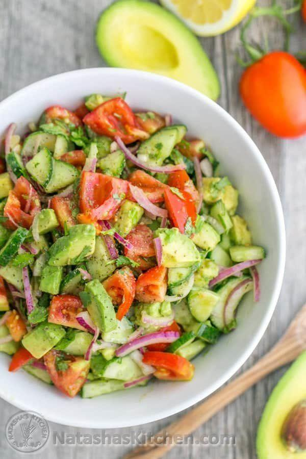 """<strong>Get the <a href=""""https://natashaskitchen.com/cucumber-tomato-avocado-salad/"""" target=""""_blank"""" rel=""""noopener noreferrer"""">Cucumber Tomato Avocado Salad</a> recipe from Natasha&rsquo;s Kitchen.</strong>"""