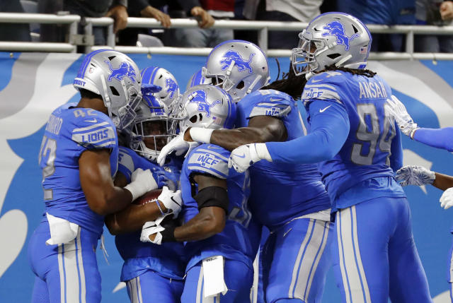 Detroit Lions cornerback Quandre Diggs (28) celebrates with teammates after an interception of a New York Jets quarterback Sam Darnold pass for a touchdown in the first quarter of an NFL football game in Detroit, Monday, Sept. 10, 2018. (AP Photo/Rick Osentoski)