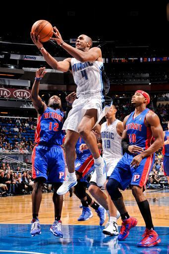 ORLANDO, FL - NOVEMBER 21: Arron Afflalo #4 of the Orlando Magic shoots a layup against Will Bynum #12 and Corey Maggette #50 of the Detroit Pistons on November 21, 2012 at Amway Center in Orlando, Florida. (Photo by Fernando Medina/NBAE via Getty Images)