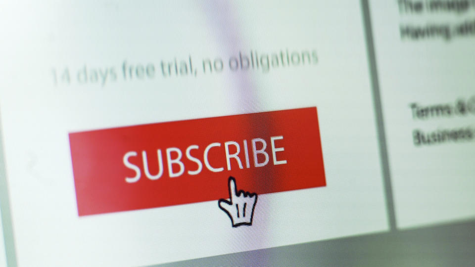 "Stock close up image showing a ""subscribe"" button on a website with hand shaped cursor."