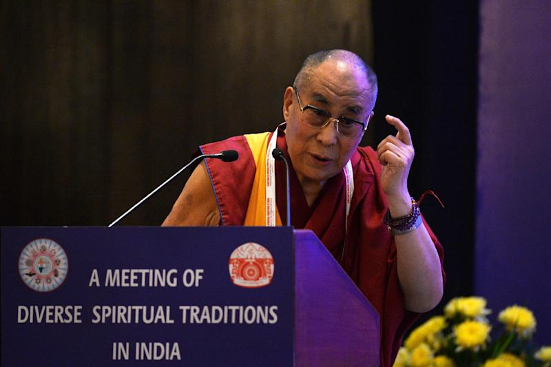His Holiness Dalai Lama speaks during an inter-religious meeting for harmony in New Delhi on September 20, 2014