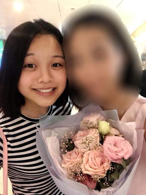 Chan Yin-lam was captured on security camera leaving some of her personal possessions, including a mobile phone, outside an exit at Tiu Keng Leng MTR station before walking away. Photo: Handout
