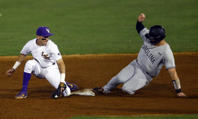 South Carolina's Luke Berryhill (14) beats the tag from LSU second baseman Brandt Broussard (16) as he steals second base during the second inning of a Southeastern Conference tournament NCAA college baseball game Tuesday, May 21, 2019, in Birmingham, Ala. (AP Photo/Butch Dill)