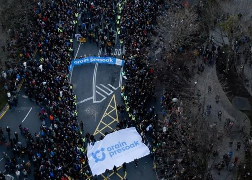 """Protesters hold a banner reading """"Now the Bask prisoners"""" during a protest in the northern Spanish city of Bilbao to demand the transfer of ETA prisoners to jails near their homes"""